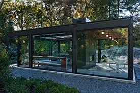 modern green house a glass house in the garden contemporist