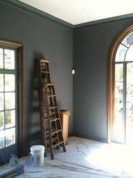 crown molding painted the same color as the walls make the