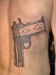 45 amazing gun tattoo designs