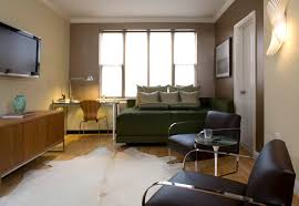 studio apartment design ideas and tips to live stylishly traba homes marvellous studio apartment design decorated with wooden cabinet facing the twin arm chairs