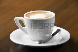 macchiato espresso coffee in white cup with nice spoon stock photo