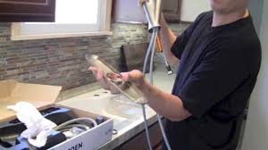 install kitchen faucet with sprayer how to install a kitchen faucet by