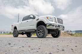 lifted nissan frontier rough country 6in suspension lift kit u2013 2016 titan xd 4wd