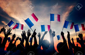 Flags In Group Of People Waving French Flags In Back Lit Stock Photo