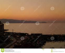 deep orange color of the evening at heraklion old venetian harbor