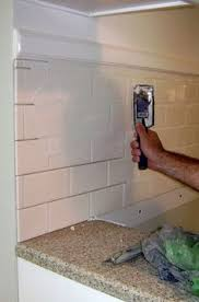 Installing Tile Backsplash How I Transformed My Kitchen With Paint Painted Tiles Oil And Easy