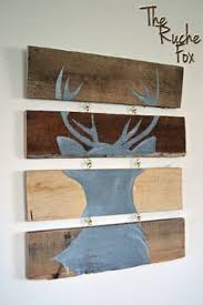 grey and white distressed deer head silhouette wood sign art