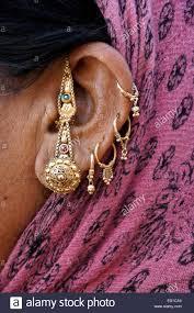 gujarati earrings gold adornments on ear of gujarati woman patan gujarat india