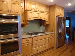 nifty modular kitchen design featuring oak wood cabinet with