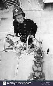 a fireman on a turntable ladder 1960 u0027s style uk stock photo