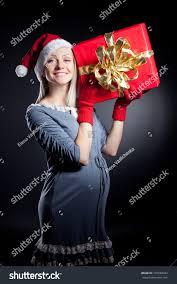 beautiful pregnant woman wearing santa hat stock photo 165584042