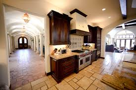 two tone cabinets in kitchen kitchen kitchen in spanish design with terra cotta tile flooring