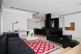 sculptural tel aviv apartment redesigned with custom furniture