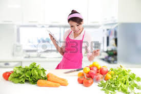 femme nue cuisine smile in kitchen holding tablet pc computer with health