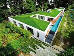 sloped roof home with skylight courtyard kerala design and house