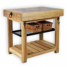 striking antique butcher block kitchen island with black wrought