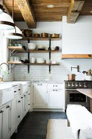 Spanish Style Kitchen Cabinets Brown Late Concrete Floor Beige Cabinets White Dishwasher Rustic