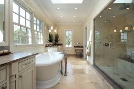 travertine bathrooms traditional master bathroom with raised panel by at home dsm
