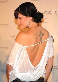 nice feminine wording cross tattoo on upper back for women