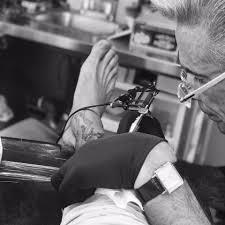 shin tatoos david beckham adds to huge tattoo collection with shin inking days
