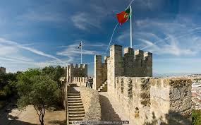 castle walls and portuguese flag picture sao jorge castle lisbon