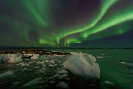 what creates the northern lights northern lights over greenland northern lights over greenland