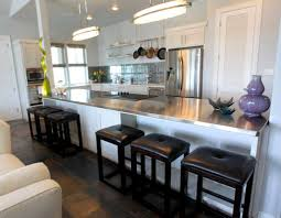 stainless steel island for kitchen tiki island home is a party palace houston chronicle