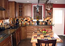 assorted color tile backsplash connected by brown wooden kitchen