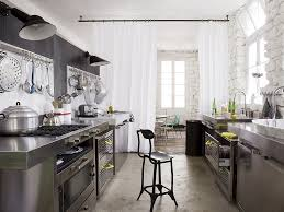 the kitchen designer stainless steel kitchen whitewashed stone walls white curtains