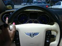 bentley steering wheel pink nails on the steering wheel of a bentley expression without