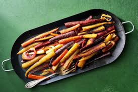 roasted ghee carrots with filfil no 7 garlic sauce