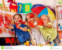 children painting finger on easel small students in art