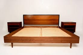 glossy varnished walnut wood bed fram with wegner danish modern