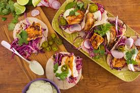rachael ray rachaelray com recipes food feedback inspiration chipotle grilled fish tacos with tequila lime slaw and avocado crema