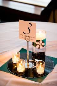 another view of center pieces groomsmen and the godfather buca restaurant wedding photography