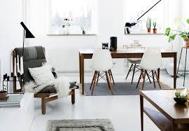 exposed beige brick wall along single orange comfort chairs purple
