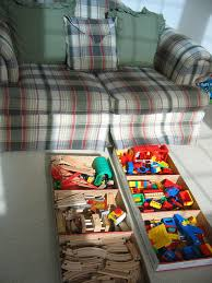 Under Sofa Storage by Controlling Craziness Out Of Sight Toy Storage