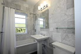 White Marble Tile Bathroom With Blue Accent Ideas Carrara Marble Bathroom Designs