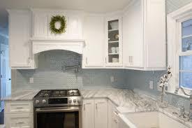 an elegant kitchen design with a curved milk glass tile backsplash