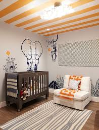 baby nursery jungle style nursery features striped orange ceiling