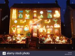Christmas Lights House by House Front Covered In Garish Christmas Lights Cornwall England Uk