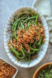 garlic green beans with mushrooms and crispy shallots on