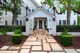 fence design with brick front gate also paver walkway ideas