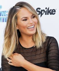 chrissy teigen looks totally different with long brown curls