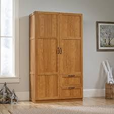 sauder kitchen storage cabinets amazon com sauder large storage cabinet highland oak kitchen dining
