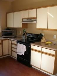 painting laminate kitchen cabinets bathroom update how to paint laminate cabinets laminate cabinets