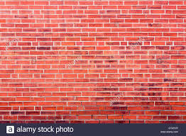 bright red brick wall background with dark stains and copy space