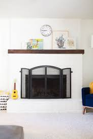 how to paint a brick fireplace white lovely indeed