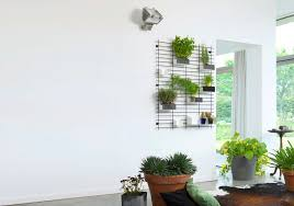 indoor living wall planter modular made of wire having small shelf