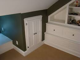 insulated attic access door with traditional hall and art bookcase